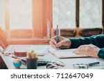 businessman hands with pen... | Shutterstock . vector #712647049