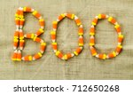 Small photo of candy corn letters spelling out BOO on a tan linen cloth