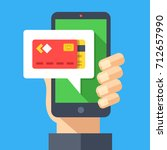 pay with your smartphone. hand... | Shutterstock .eps vector #712657990