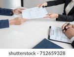 interviewer or board reading a... | Shutterstock . vector #712659328