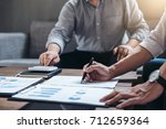 young businessteam working with ... | Shutterstock . vector #712659364