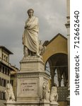 Small photo of Close-up of the statue of Dante Alighieri which is adjacent to the cathedral of Florence where his remains rest