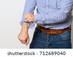 middle aged man rolling up the... | Shutterstock . vector #712689040