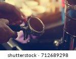 barista making coffee   | Shutterstock . vector #712689298