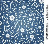 floral pattern on denim... | Shutterstock .eps vector #712689568