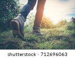 woman hiker hiking in rocky... | Shutterstock . vector #712696063