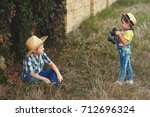 brother and sister on the walk. ... | Shutterstock . vector #712696324