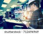 double exposure of engineer or... | Shutterstock . vector #712696969