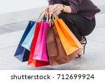 woman holding shopping bag
