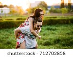 a young girl sits on the back... | Shutterstock . vector #712702858