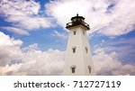 Dreamy lighthouse against cloud filled sky in Gulfport, Mississippi