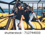 two model wearing plain black t ... | Shutterstock . vector #712744033