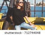 model wearing plain black t... | Shutterstock . vector #712744048