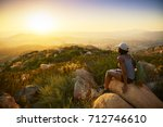 rear view of woman hiker... | Shutterstock . vector #712746610