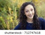 beautiful hispanic teen girl... | Shutterstock . vector #712747618