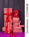 a slide of gifts in a red and... | Shutterstock . vector #712748638