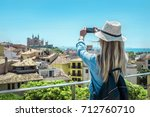 woman tourist with her phone... | Shutterstock . vector #712760710