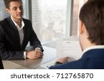 back view of hiring manager... | Shutterstock . vector #712765870