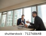 financial director explaining... | Shutterstock . vector #712768648