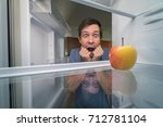 hungry man is looking for food... | Shutterstock . vector #712781104