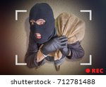 thief or robber with bag full... | Shutterstock . vector #712781488