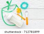 children feeding with... | Shutterstock . vector #712781899
