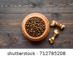 Stock photo large bowl of pet dog food on wooden background top view mockup 712785208