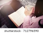 woman reading a book and... | Shutterstock . vector #712796590