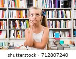 blonde girl child puzzled of... | Shutterstock . vector #712807240