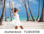 woman enjoying vacation at the... | Shutterstock . vector #712810558
