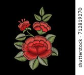 roses and leaves. embroidered... | Shutterstock .eps vector #712819270