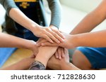young group are join hands for... | Shutterstock . vector #712828630