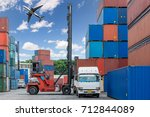 forklift handling container box ... | Shutterstock . vector #712844089