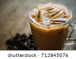 cold coffee on wood background. | Shutterstock . vector #712845076