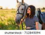 beauty brunette woman with... | Shutterstock . vector #712845094