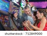 people gambling in a casino... | Shutterstock . vector #712849000