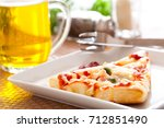 pizza ham with beer served | Shutterstock . vector #712851490