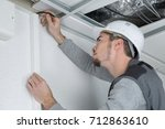man marking position of cable... | Shutterstock . vector #712863610