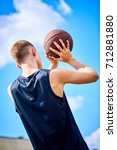 male playing basketball outdoor | Shutterstock . vector #712881880
