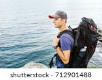 man traveler with backpack...   Shutterstock . vector #712901488