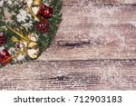 christmas decoration on wooden... | Shutterstock . vector #712903183