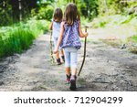Stock photo children identical twins girls are hiking in the mountains active family parents and children 712904299