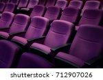 purple comfort seat in theater. | Shutterstock . vector #712907026