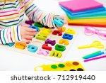 child doing homework for school ... | Shutterstock . vector #712919440