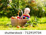 child picking apples on a farm... | Shutterstock . vector #712919734