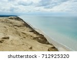 sand dunes at the danish north... | Shutterstock . vector #712925320