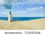 lighthouse rubjerg knude and... | Shutterstock . vector #712925326