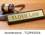 a gavel and a name plate with... | Shutterstock . vector #712941016