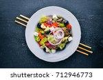 greek salad. fresh vegetables...   Shutterstock . vector #712946773