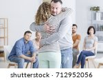 caucasian couple embracing in... | Shutterstock . vector #712952056